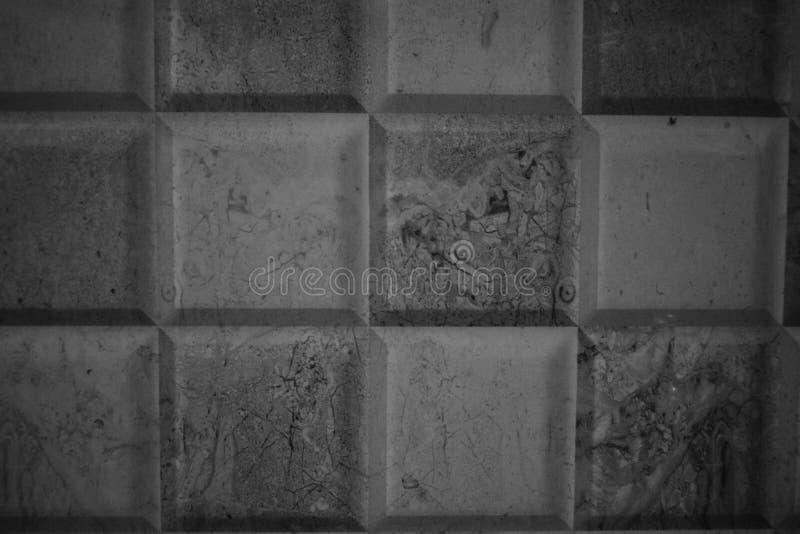 Fine su struttura in bianco e nero delle mattonelle immagini stock libere da diritti
