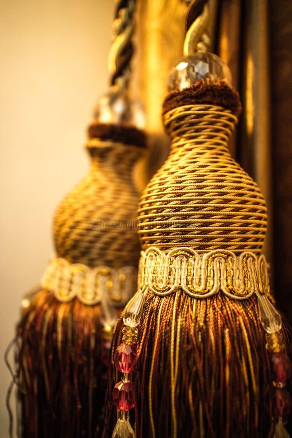 Fine sulle vecchie nappe d'annata classiche dell'oro alla luce calda fotografie stock libere da diritti