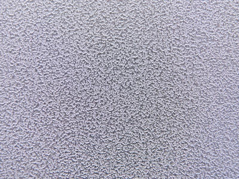 Fine texture on a white surface. light uniform background. royalty free stock image