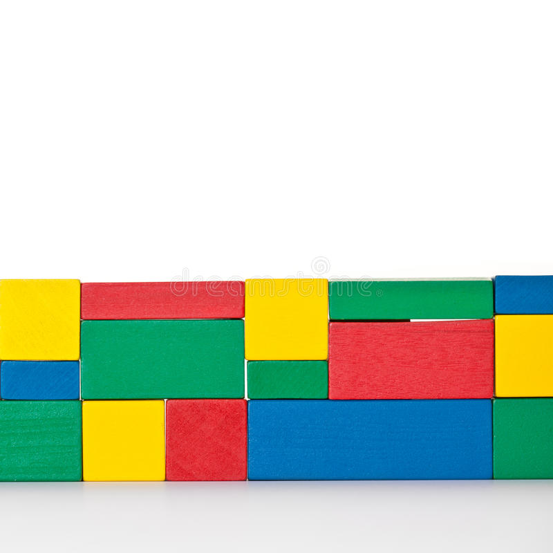 Fine wall of colored building blocks. Wall of colored building blocks. All on white background stock photos