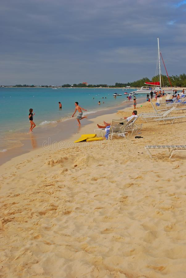 Fine white sand and crowd at Seven Mile Beach, Cayman Island stock images