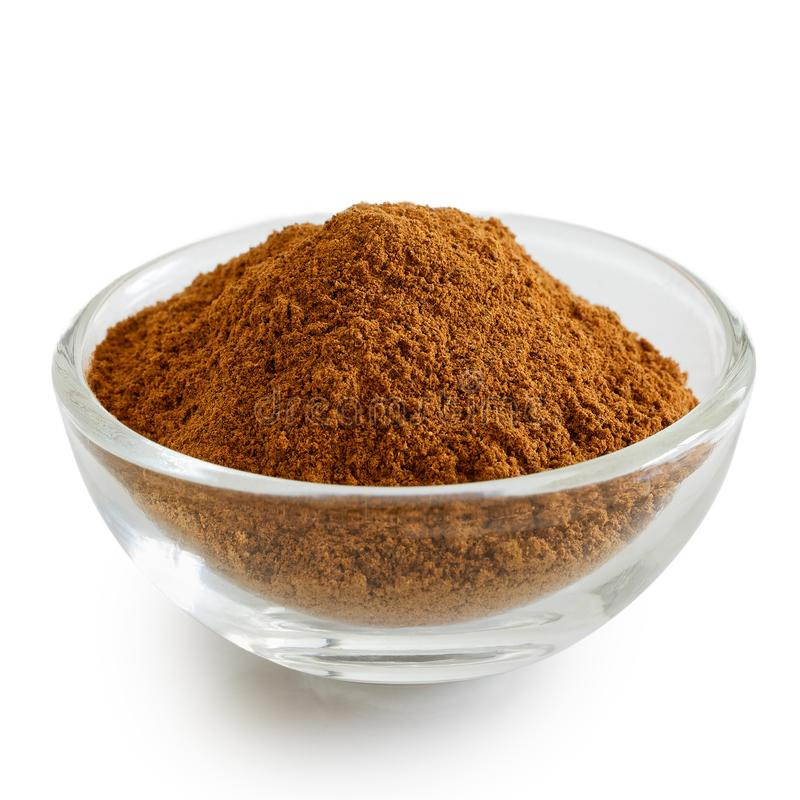 Finely ground cinnamon in glass bowl. royalty free stock photos