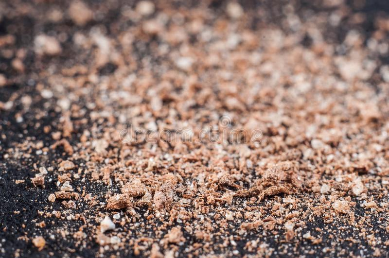 Finely ground cinnamon powder, on a dark background. Macro shooting stock photography