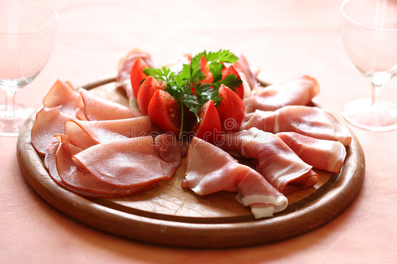 Finest gammon. With slices of tomatoes and parsley stock photo