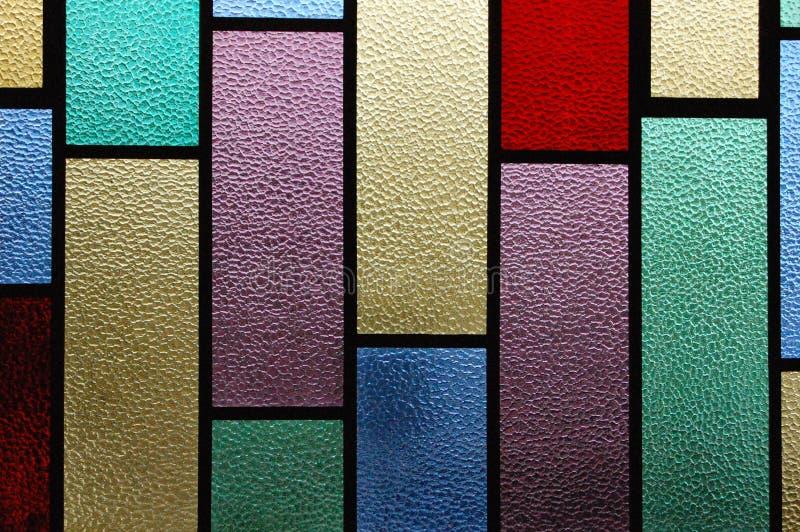 Finestra di vetro della macchia immagini stock