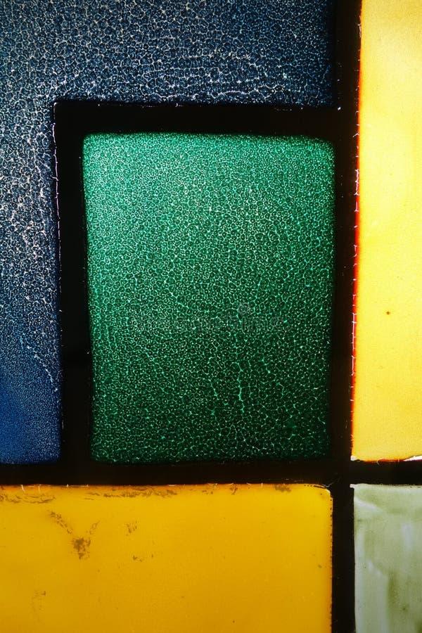 Finestra di vetro macchiato crannied molto vecchia fotografie stock