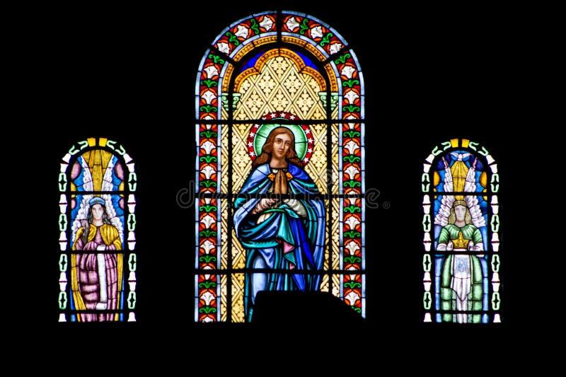 Finestra di vetro macchiato religioso nell'immagine Gesù fotografie stock
