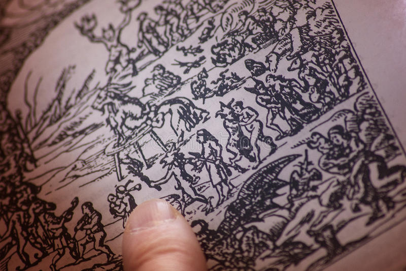 Finger of the alchemist, on the book with spells, runes, pentagram stock photos