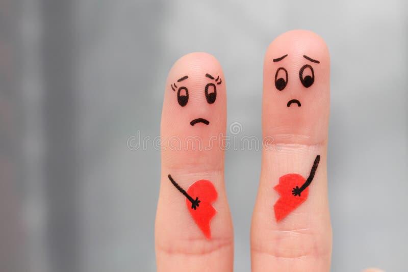 Finger art of couple holding broken heart. stock images