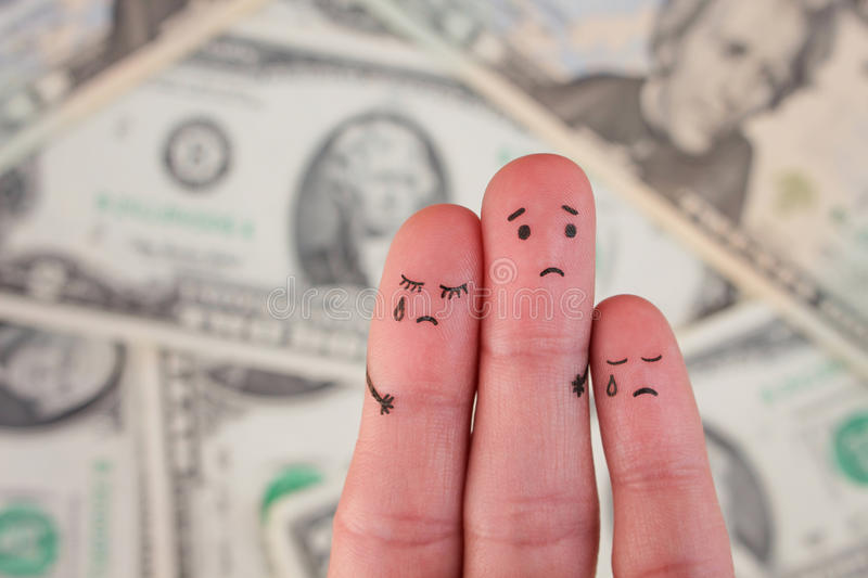 Finger art of displeased family on background of money. stock image