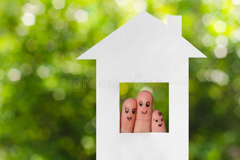 Finger art of a family. Family looking out of the window of the house out of paper royalty free stock images