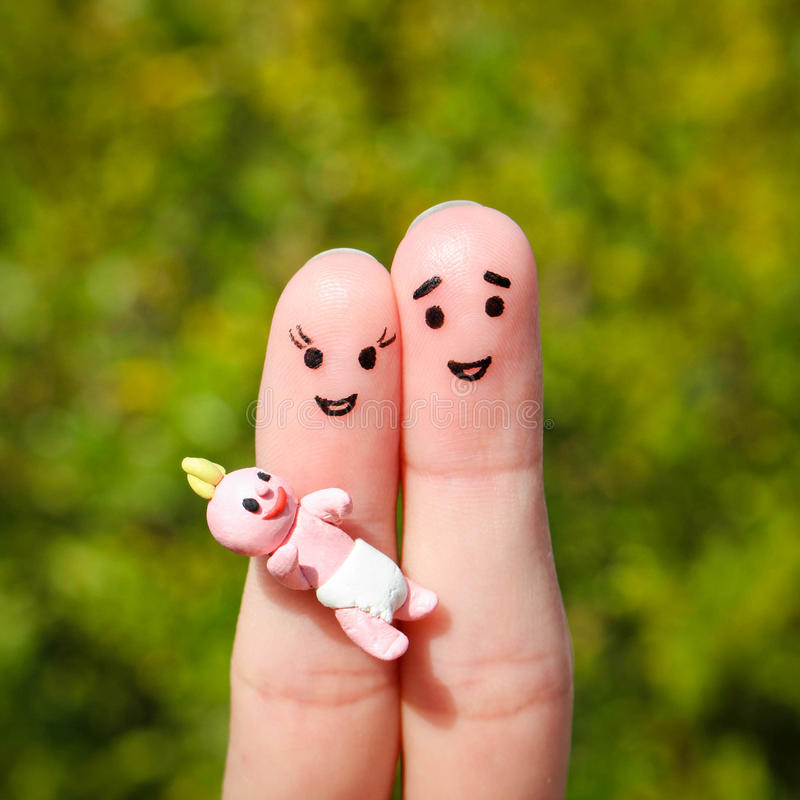 Finger art of a Happy couple. Happy family holding a small child royalty free stock photography