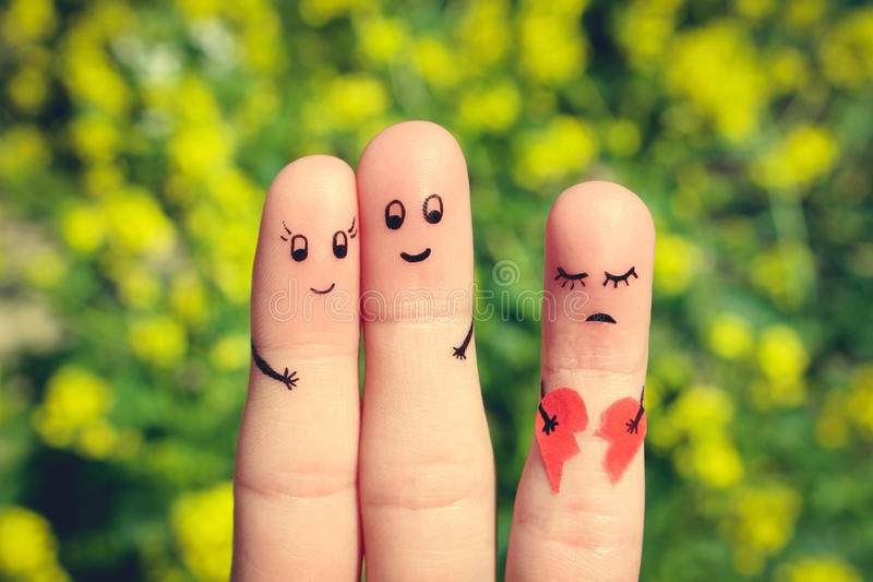 Finger art of Happy couple hugging. Other girl is holding broken heart. royalty free stock photography