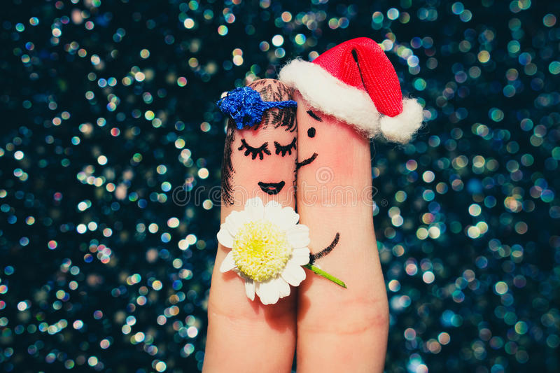 Finger art of a Happy couple. Man is giving flowers to a woman. Toned image royalty free stock photography