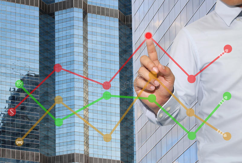 Finger of businessman touch to the peak of business graph on Sky. Scraper background,concept to success and profitability royalty free stock photos