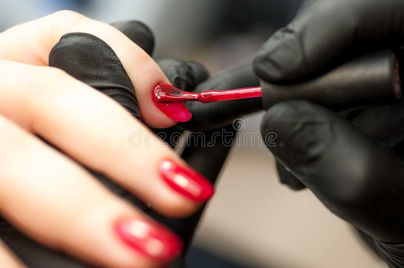 Finger care, cleaning in the beauty salon macro royalty free stock image