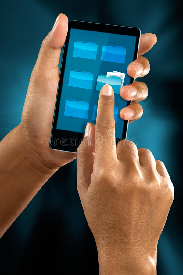 Finger clicking a folder icon. A woman finger select a folder icon on a mobile phone menu royalty free stock images