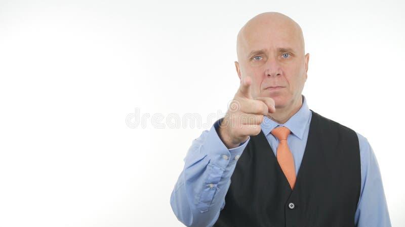 Finger confiado y serio de Image Pointing With del hombre de negocios imágenes de archivo libres de regalías