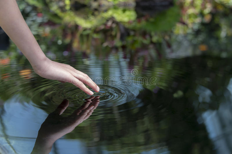Finger creating ripples royalty free stock images