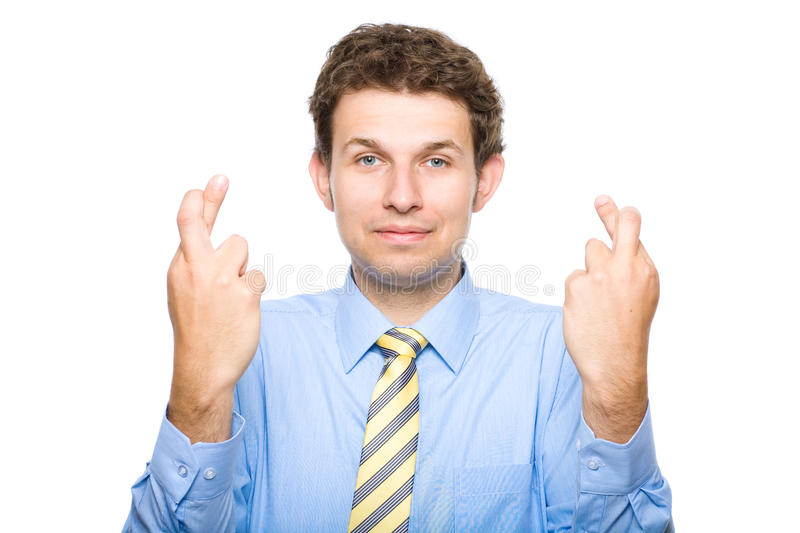 Finger crossed, young businessman, isolated royalty free stock photos