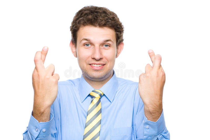 Finger crossed, young businessman, isolated stock photos
