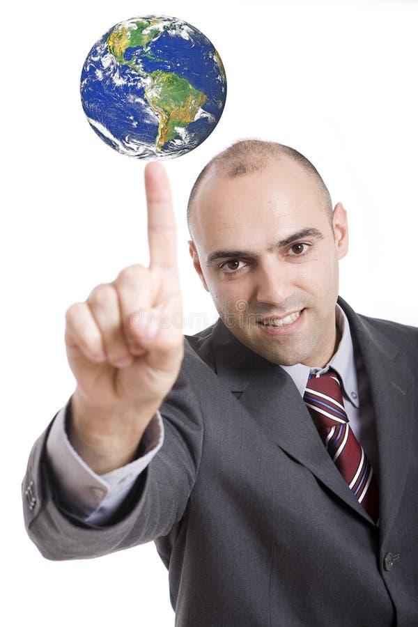 Finger, der auf die Kugel zeigt lizenzfreie stockfotos