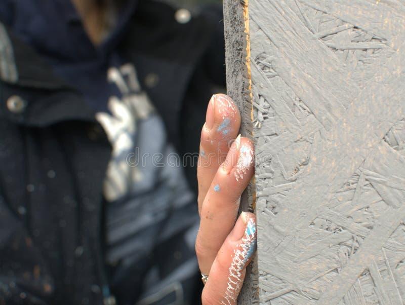 Finger eines Malers lizenzfreie stockbilder
