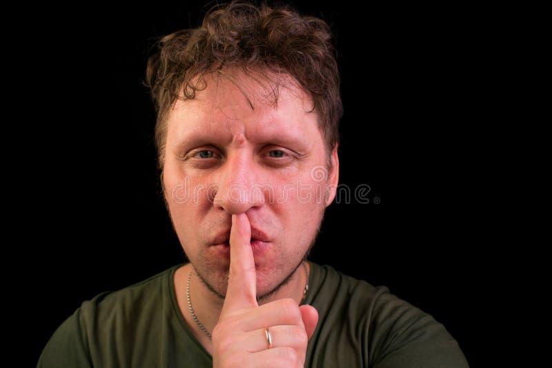 Finger en la boca No hable ¡Tranquilidad! fotografía de archivo