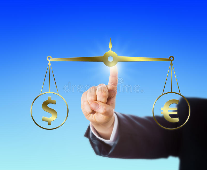 Finger Equating A Dollar At Par With A Euro Sign. Index finger is equating the Dollar sign at par with the Euro symbol on a golden pair of balances. Right arm of royalty free stock image