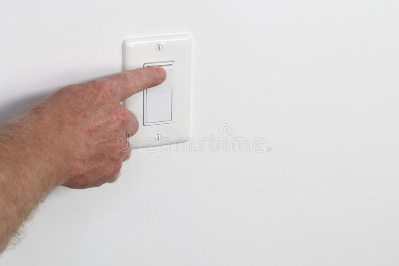 Finger Flipping a White Light Switch from the Left royalty free stock photo