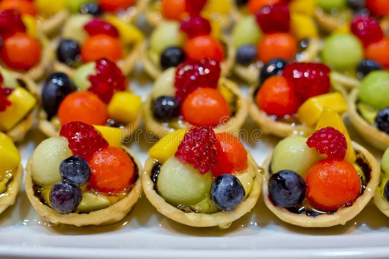 Finger food, dessert and fruits cocktail stock photos