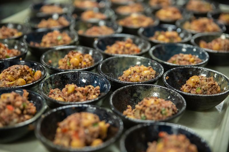 Finger food dishes full will quinoa salad is ready to be served royalty free stock photos