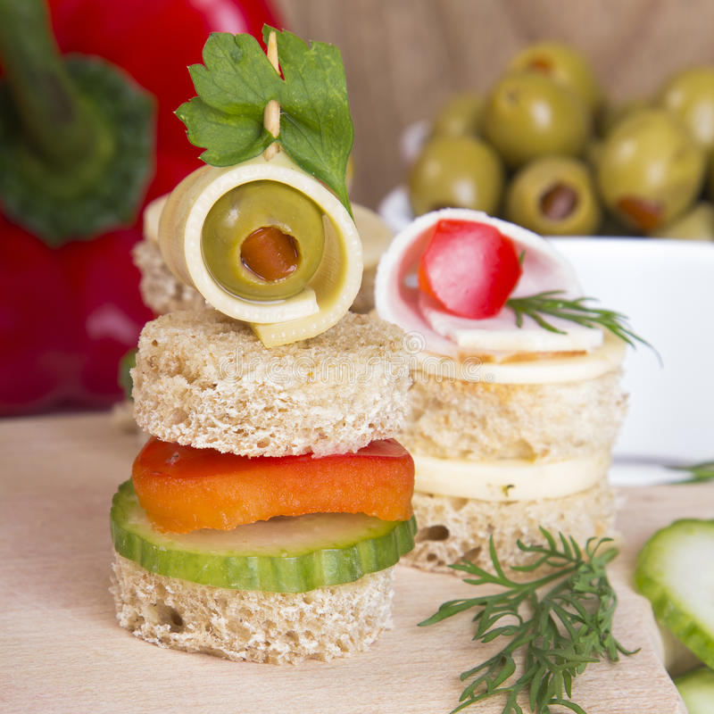 Finger foods. Bread, peppers, cucumber, cheese and olives royalty free stock images