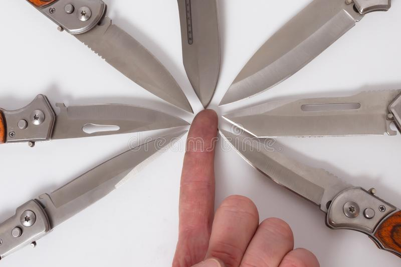 Finger hand man folding knives eight blades directed inwards. stock images