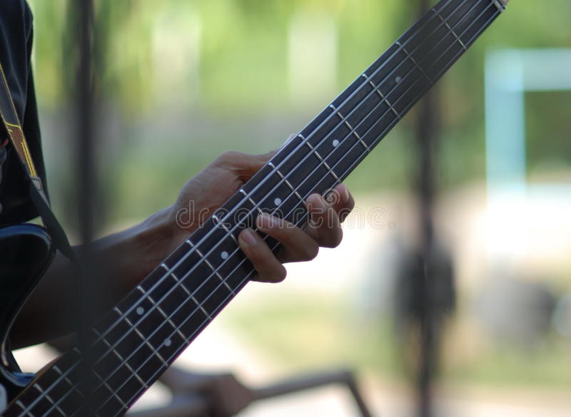 finger hand of music man play electric guitar bass in thailand f royalty free stock image