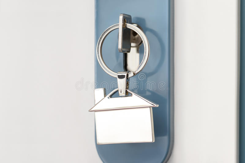 Finger inserting key in keyhole stock images