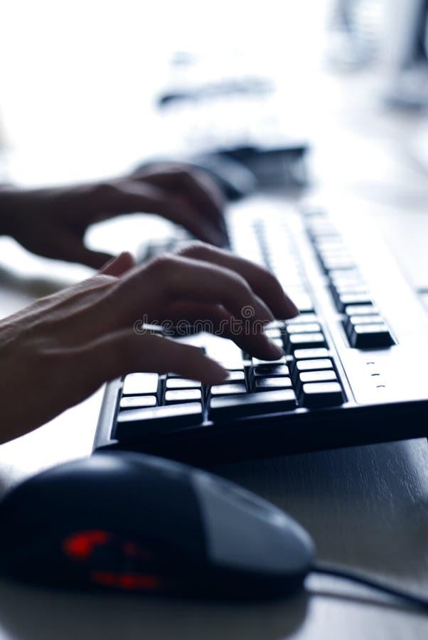 Finger on keyboard. Writing fingers on computer keyboard stock photo
