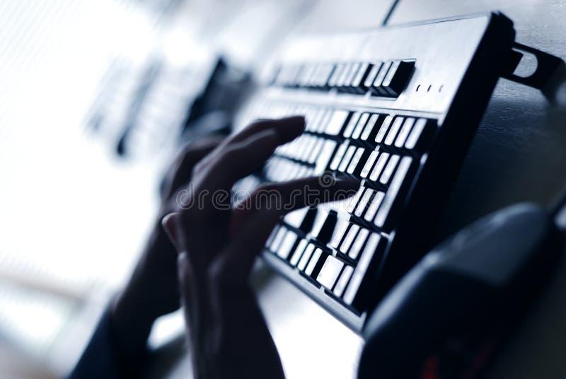 Finger on keyboard. Writing fingers on computer keyboard stock image