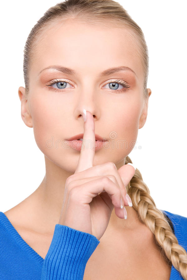 Finger on lips stock images
