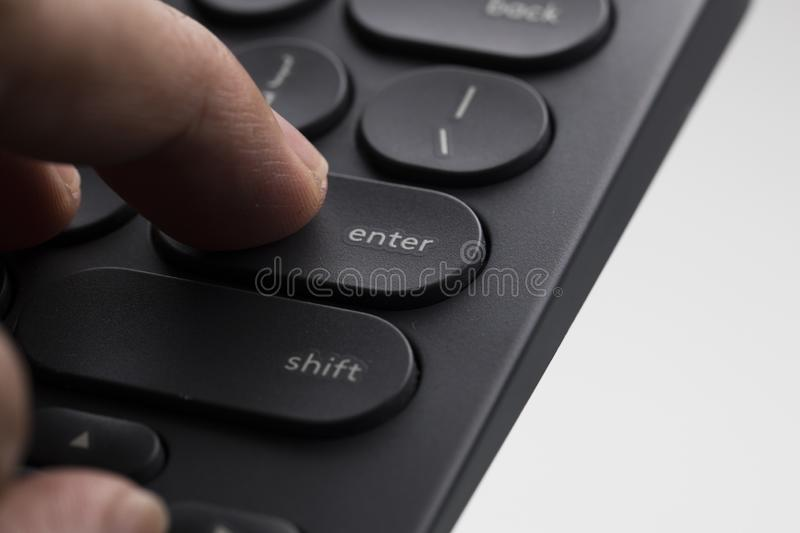 Finger over enter key royalty free stock photo