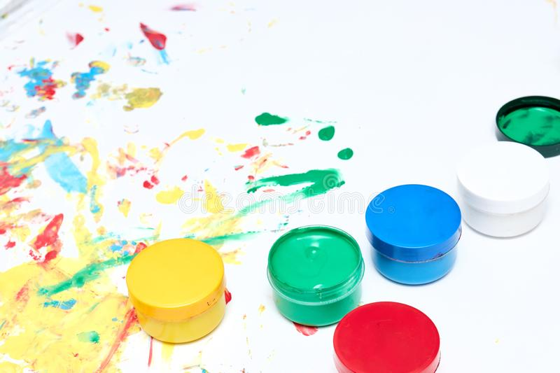 Finger paints. background for advertising from children`s finger paint. Copy space. items for the development of children royalty free stock image