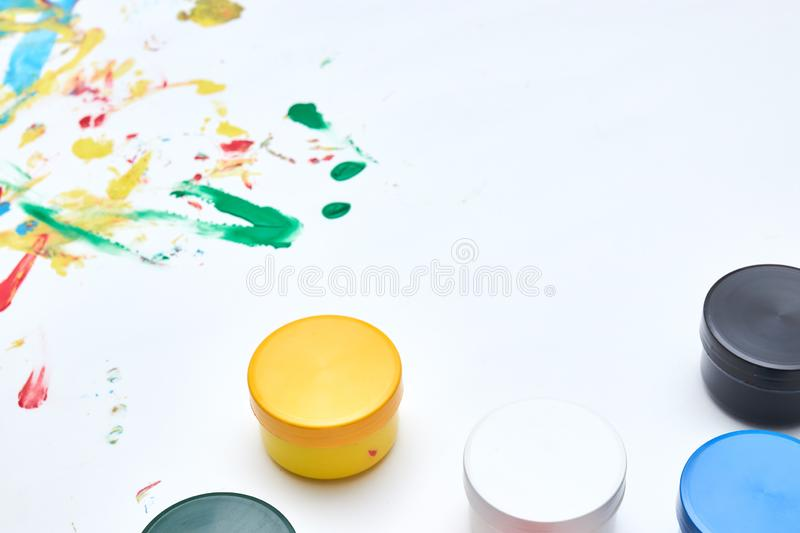 Finger paints. background for advertising from children`s finger paint. Copy space. items for the development of children stock images