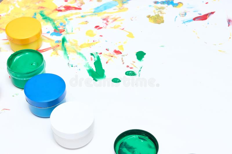 Finger paints. background for advertising from children`s finger paint. Copy space. items for the development of children royalty free stock photo