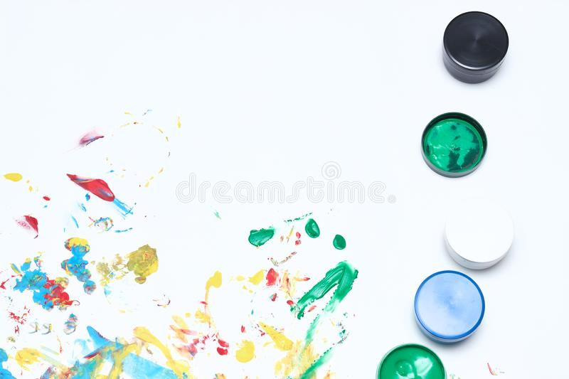 Finger paints. background for advertising from children`s finger paint. Copy space. items for the development of children stock photo
