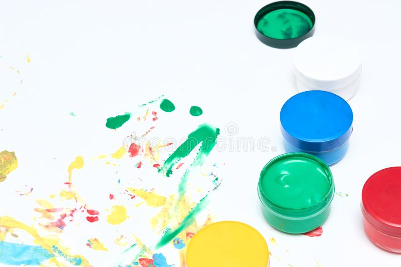 Finger paints. background for advertising from children`s finger paint. Copy space. items for the development of children stock photography