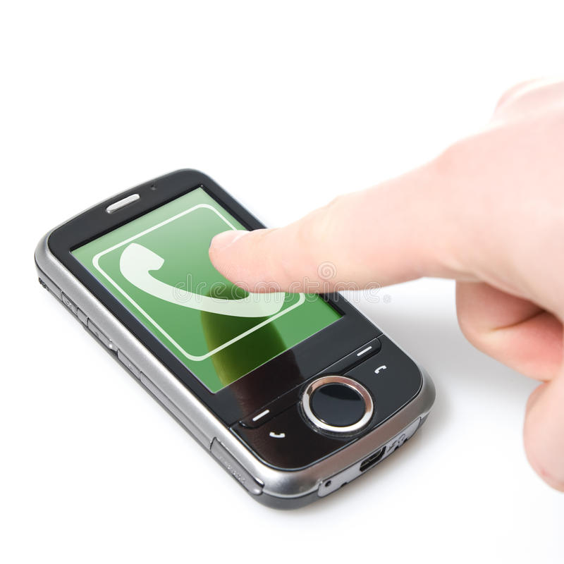Finger and pda with incoming call. Isolated on white stock photography