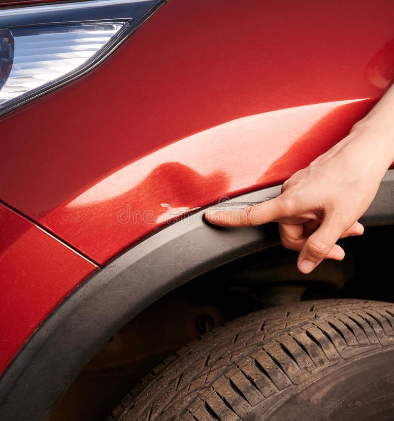Finger point at car scratch royalty free stock photography