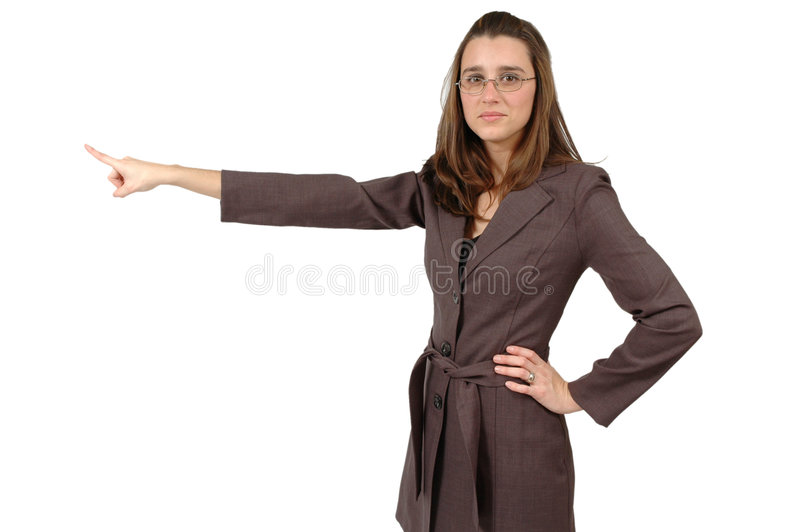Finger Pointing. Business woman who is wearing glasses points her finger off to her side. Horizontal crop on white. Use this space to advertise royalty free stock photography