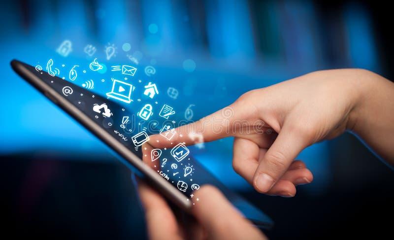 Finger pointing on tablet pc, social media concept. Hand touching tablet pc, social media concept