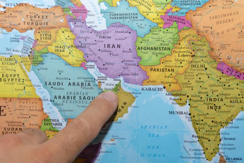 Finger pointing to a colorful country map of the United Arab Emirates Dubai in the Middle East on Gulf royalty free stock photo
